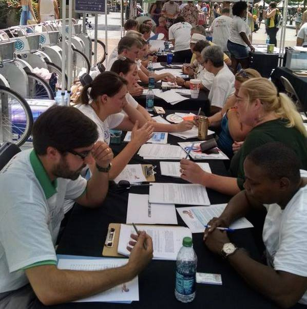 (Individuals complete Health Care Power of Attorney documents at Charlotte Pride.)